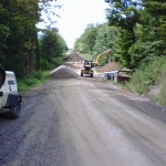 Day 1: Excess material is piled on road and will be reused