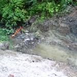 Day 1: New 7' diameter pipe will be set slightly below creek level.