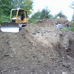 Day: 4 Stockpiled original material is reused for cover.  View west Francis Rd