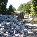 Day 5: Large R-7 rock brought in to protect the inlet and roadside berm from erosion