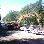 Day 6:  Old pipe being smashed to be hauled to the scrap yard